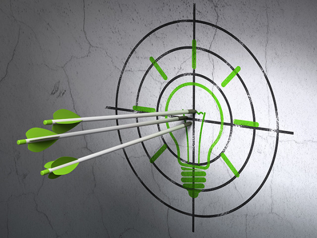 Finance concept: arrows in Light Bulb target on wall background