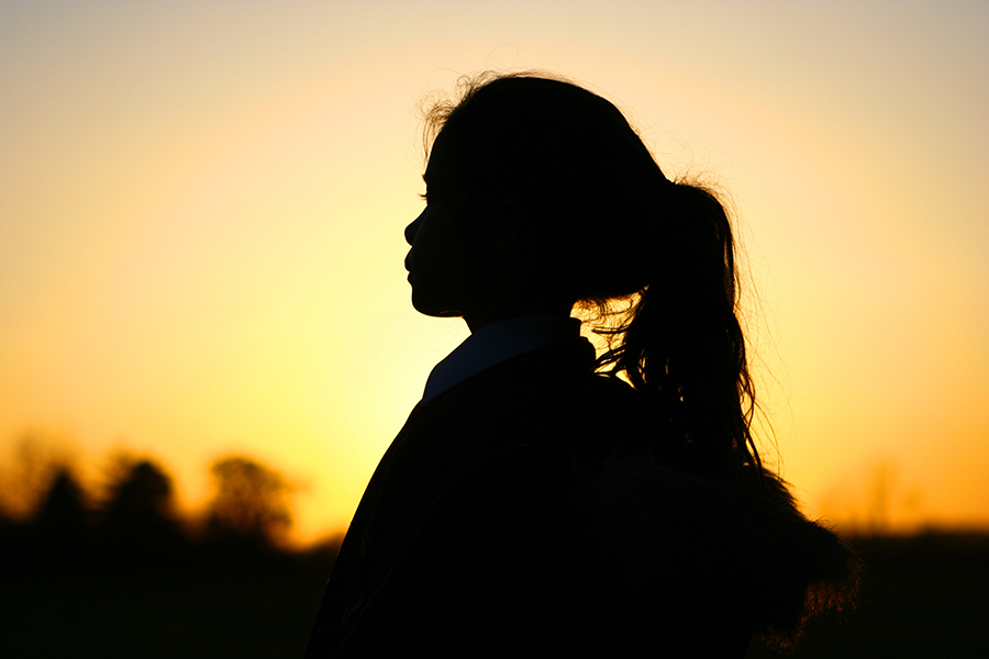 silhouette of a girl against a beautiful sunset