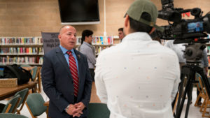 Manny Santa Cruz, D.N.P., M.B.A., R.N., assistant dean and chair of undergraduate programs at the Gayle Greve Hunt School of Nursing, spoke to the media during last week's announcement of the early-admission program for Silva Magnet High School students.