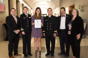 Officials from the U.S. Public Health Service honored Desiree Carmen for her research on public health issues.