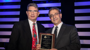 Donald Meier, M.D. (left), in May accepts the American Pediatric Surgical Association (APSA) Surgical Humanitarian Award from Ronald B. Hirschl, the immediate past president of the APSA.