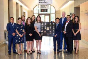 The Collegiate Double T Health Professions Honor Society presented TTUHSC El Paso President Richard Lange, M.D., M.B.A., with a shadowbox containing medals won in a variety of competitions at conferences this year.