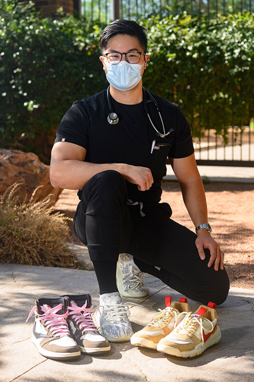 Dr. The Q Dang wears his Adidas Yeezy 380s while displaying the Nike Travis Scott 1s and Mars Yards from his extensive sneaker collection.