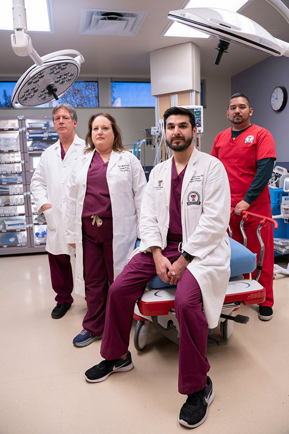 From left: Dr. Alan Tyroch, Dr. Susan McLean, Dr. Alejandro Rios Tovar and Esai Barrios were among those in UMC's emergency department on Aug. 3. - Photo by Jorge Salgado Jorge Salg