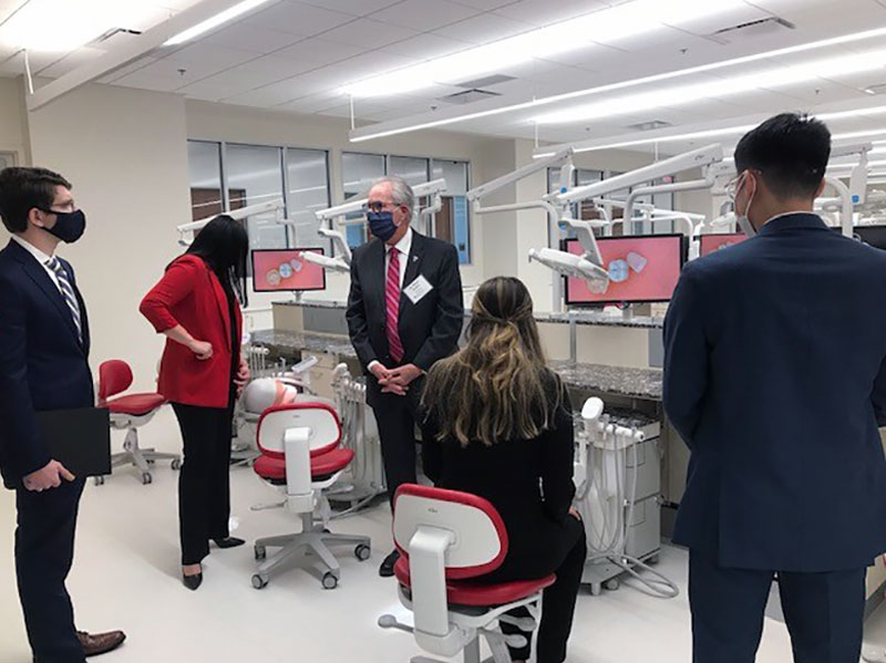 Richard Black, D.D.S., M.S., dean of the Hunt School of Dental Medicine, led prospective students on a tour of the new school's facilities.